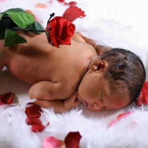 Photographe bébé à domicile www.bebekanto.fr