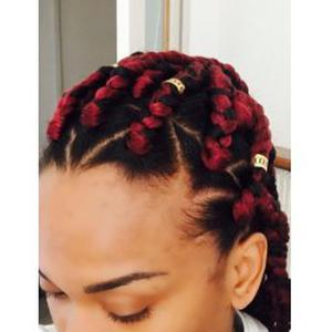 Coiffeuse à domicile spécialisé en cheveux afro