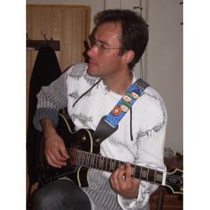 Je propose des cours de guitare et des séances de musicothérapie
